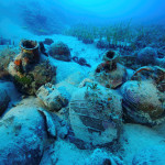 Amphorae are seen at the sea bottom at a shipwreck site on the island of Fournoi