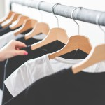 woman-choosing-t-shirts-during-clothing-shopping-at-apparel-store-2